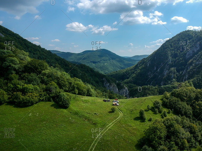 Aerial view of setting up camp for the night in the mountains around the deep cave system of Cheile Varghisului, Harghita, Romania