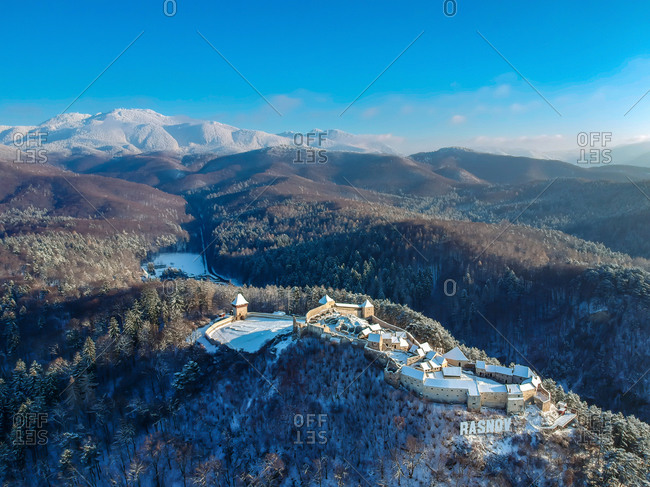 January 8, 2019: Aerial view of Rasnov Castle on the mountains above Rasnov in the winter in Brasov county, Romania