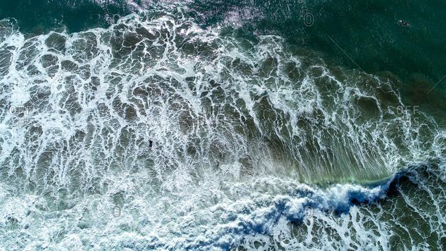 Aerial view of top down shot of wave at Farnborugh Beach, Yeppoon, Queensland, Australia