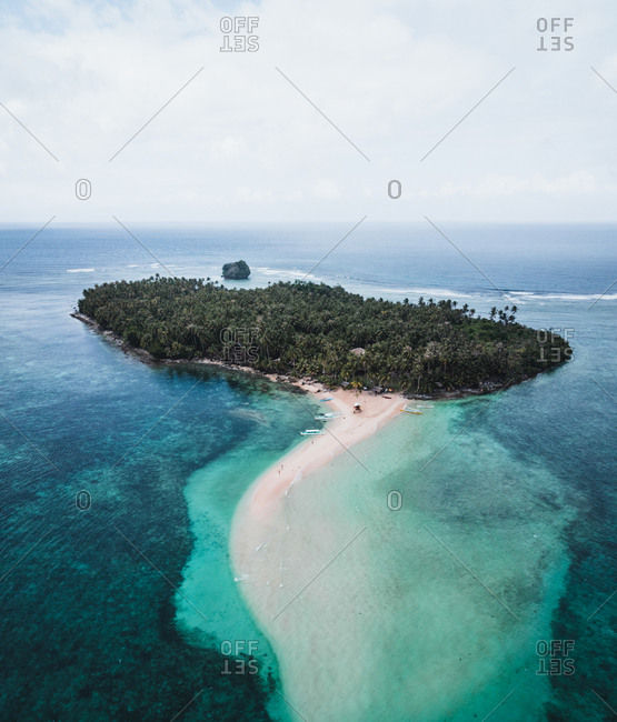Aerial view of Kawhagan Island surrounded by turquoise water, Del Carmen, Surigao del Norte, Philippines
