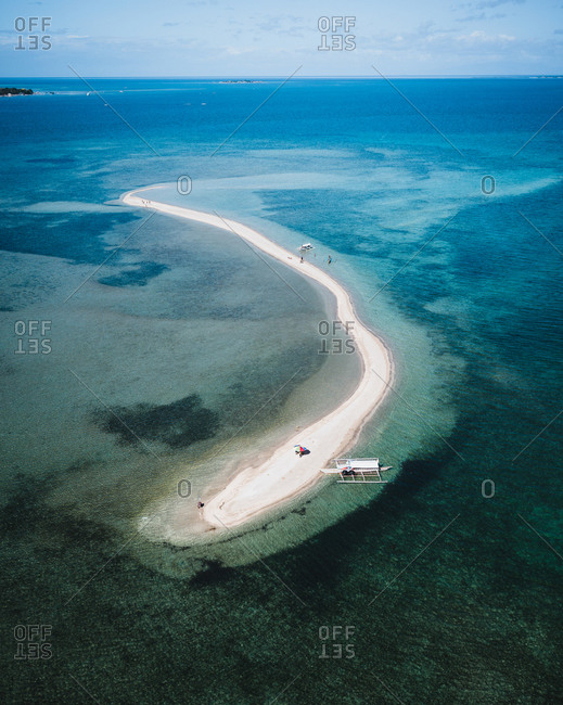 Aerial view of a sandy path in the middle of the sea in Talibon, Bohol, Philippines