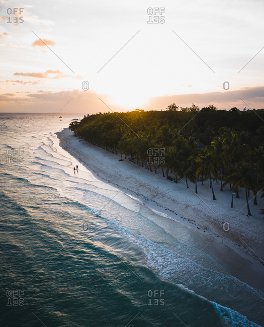 Aerial view of the beach shore at sunset in Bolod, Panglao, Bohol, Philippines