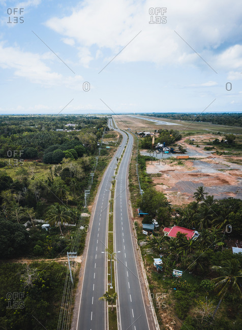 April 10, 2020: Aerial view of an empty highway due to the coronavirus pandemic in Panglao, Bohol, Philippines