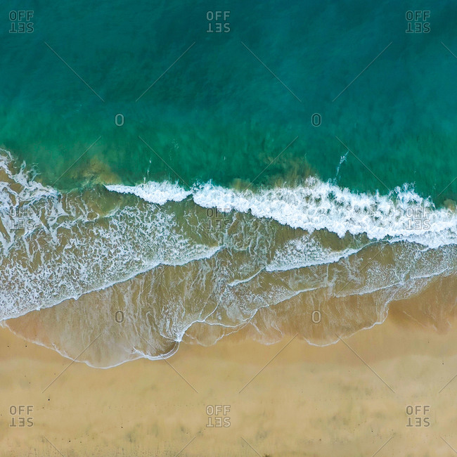 Aerial view of waves crashing on a beach in Fuerteventura Spain with vivid colors