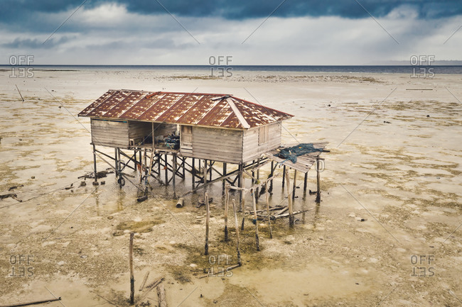 Aerial view of the fishing house at coast of Celebes Sea, Maratua, Indonesia at low tide