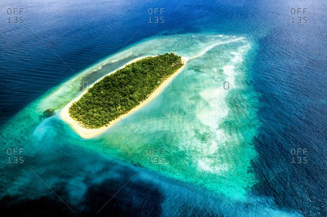 Aerial view of uninhabited island Bilang Bilangan, near Borneo, Indonesia.