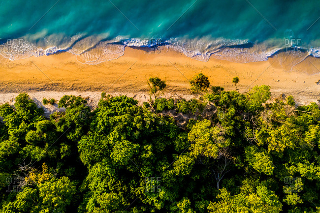 Aerial view of the shore of uninhabited island Bilang Bilangan, near Borneo, Indonesia.