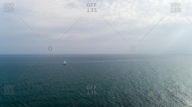 Aerial view of Sailboat in Albaron sea, Mijas Andalucia Spain.