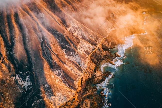 Aerial view of wild Atlantic ocean coast cliff in Fuerteventura, Canary islands.