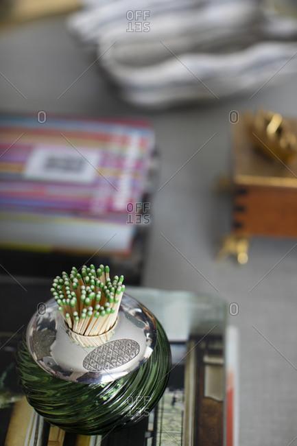 Matchsticks in a green dish