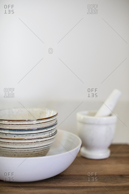 Stacked bowls and mortar and pestle