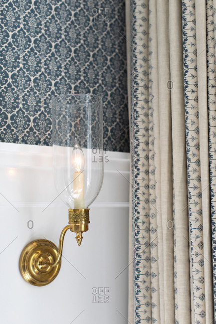 Gold wall sconce with clear glass
