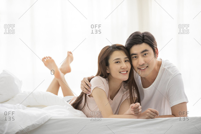 Loving Chinese couple in bed