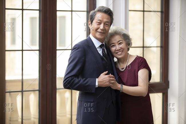 Loving senior Chinese couple at home