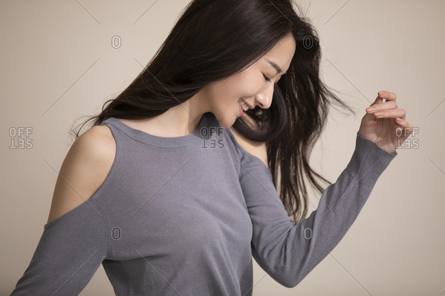 Beautiful young Chinese woman in a gray sweater