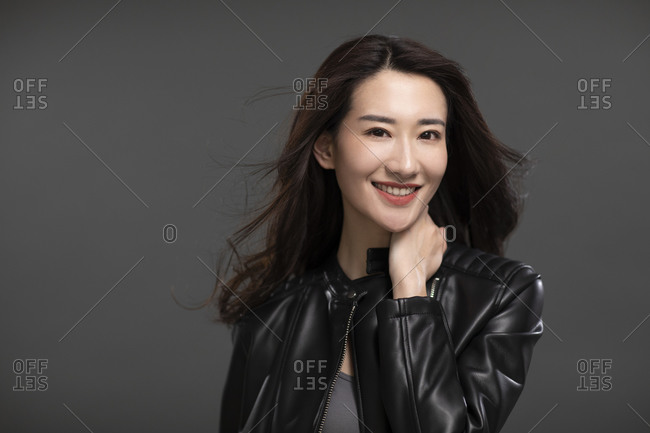 Cool young Chinese woman wearing a black leather jacket
