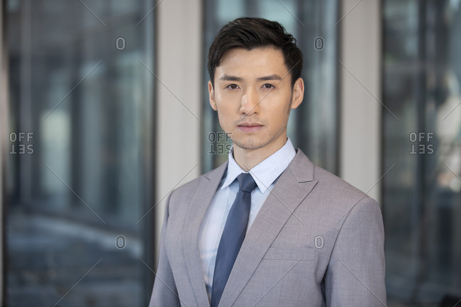 Successful Chinese businessman in a gray suit