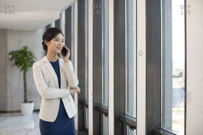 Young Chinese businesswoman using smartphone