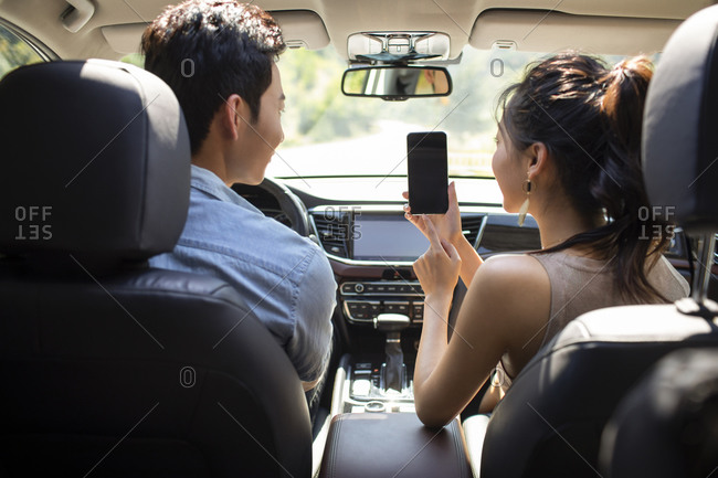 Young Chinese couple enjoying road trip