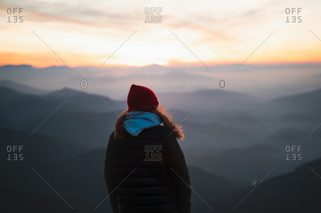 Mountaineer watches the foggy sunset in mountain Pe�as de Aya, Basque Country