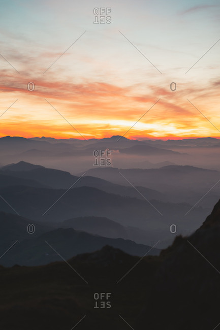 Layers of mountains on a hazy day after sunset