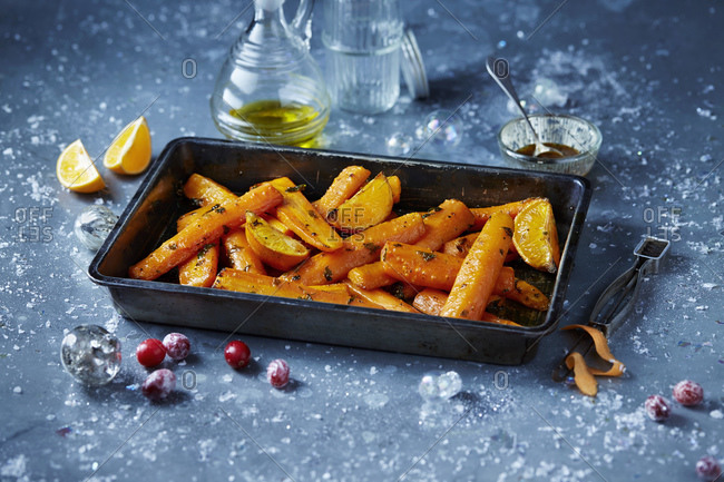 Roasted carrots in roasting tin, seasonal christmas food