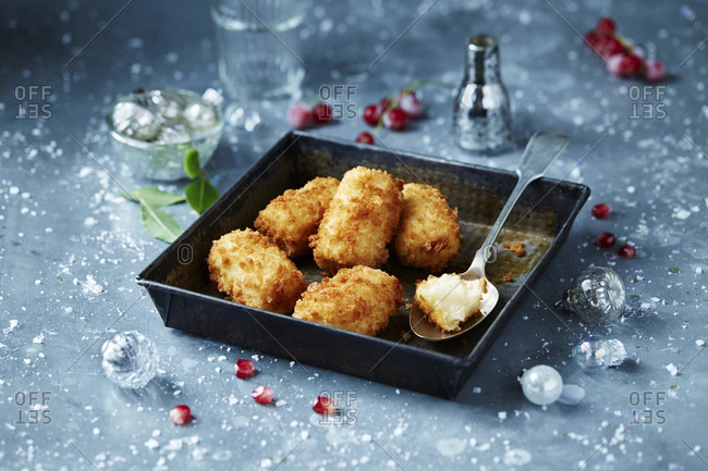 Potato croquettes in roasting tin, seasonal christmas food