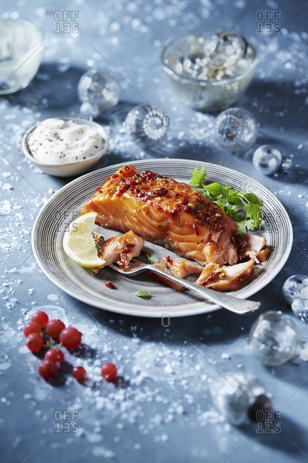 Roasted salmon fillet on plate, seasonal Christmas food