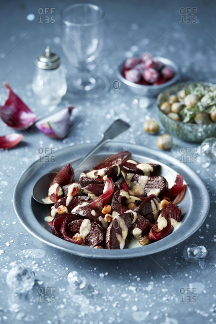 Roasted beetroot in bowl with hazelnut salad, seasonal Christmas food