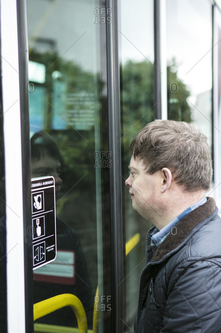 Man with down syndrome outside train door, Galway, Ireland