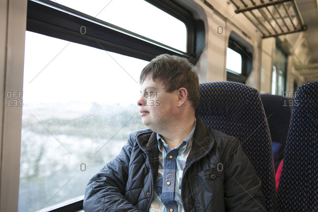 Man with down syndrome looking out of train window