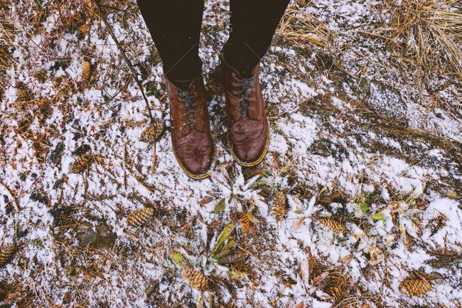 Feet of woman standing in forest in winter, Ural, Sverdlovsk, Russia