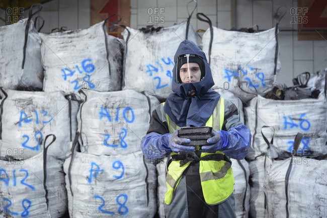 Portrait of worker in recycling factory
