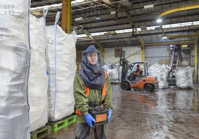 Portrait of worker in vehicle battery recycling plant