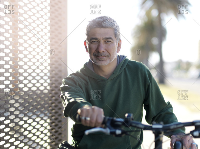 Man with bicycle enjoying sunny day, Melbourne, Victoria, Australia