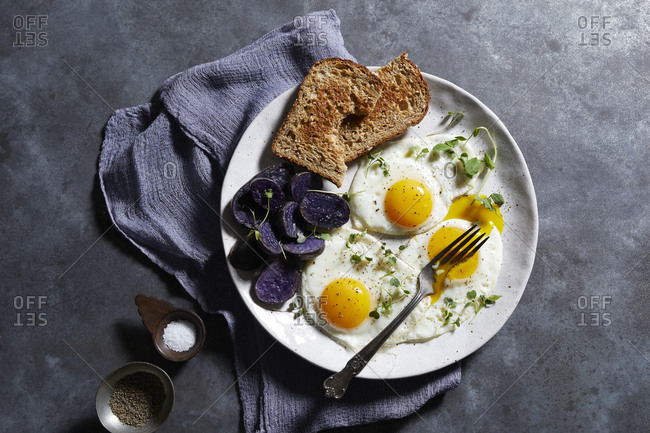 Breakfast plate of eggs and toast, overhead view