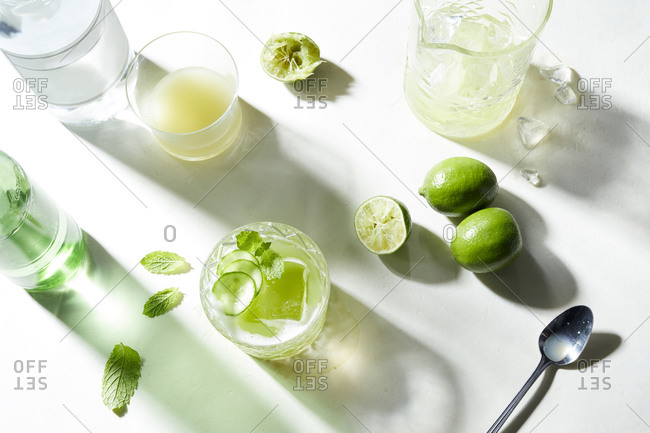Lime and soda cocktail preparation, overhead view