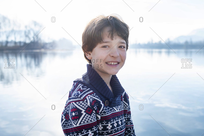 Boy on lakeside, portrait,  Lake Como, Lecco, Lombardy, Italy