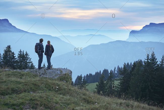 Hikers enjoying view of misty mountains, Manigod, Rhone-Alpes, France