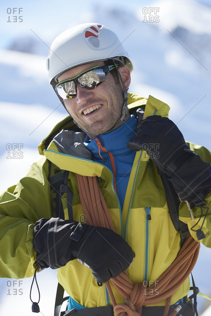 Mountaineer with climbing ropes, Chamonix, Rhone-Alps, France