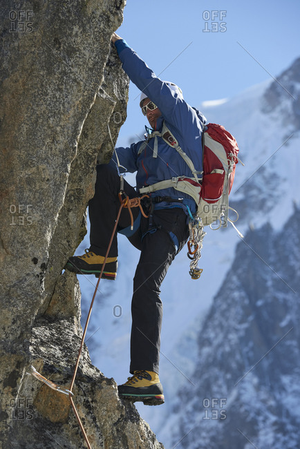 Mountaineer using harness for climb, Chamonix, Rhone-Alps, France