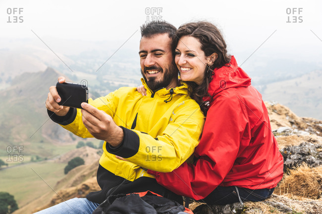 Hiker couple taking selfie, Chrome Hill, Peak District, Derbyshire