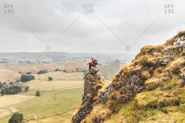 Hiker enjoying view from summit, Chrome Hill, Peak District, Derbyshire