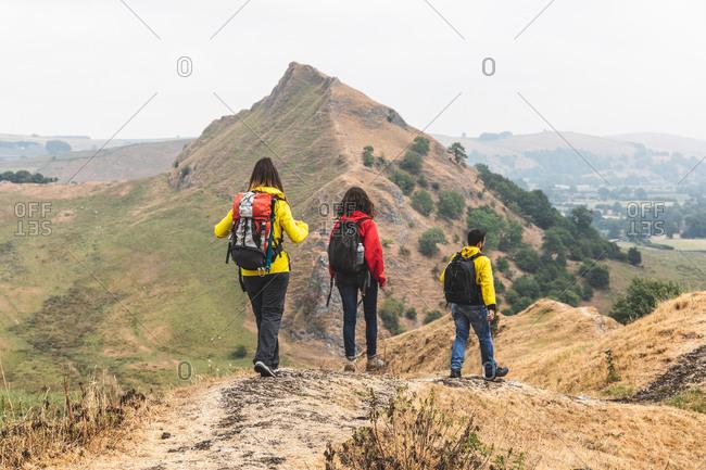 Hikers descending Chrome Hill, Peak District, Derbyshire