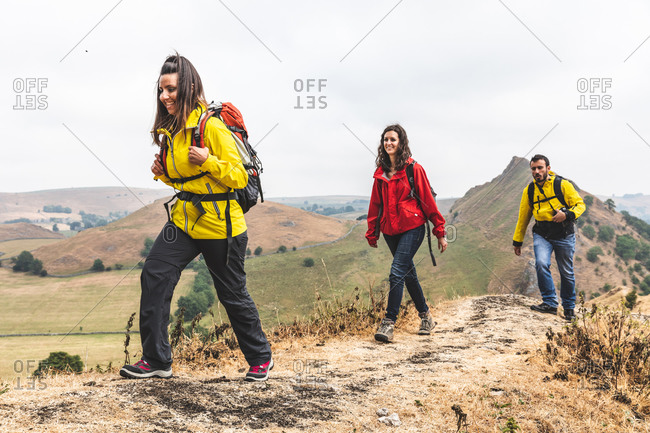 Hikers walking on ridge, Chrome Hill, Peak District, Derbyshire
