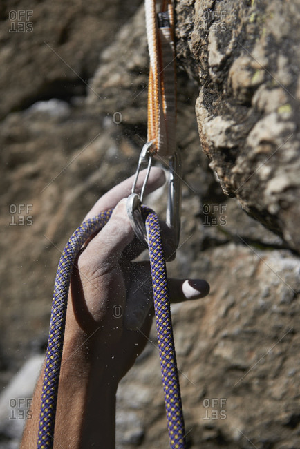 Rock climber securing harness clip