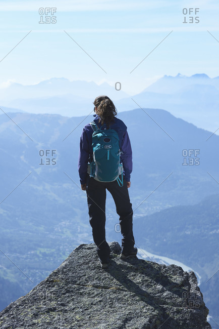 Mountain climber at summit, Chamonix, Rhone-Alps, France
