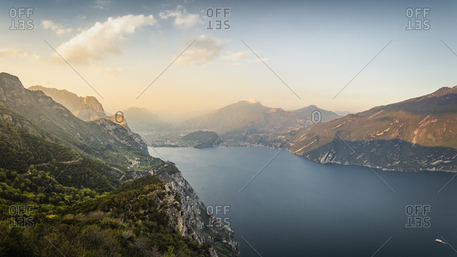 Lake Garda at sunset. Shot from near mountain village Pregasina. View north onto Riva del Garda and Torbole, Lombardia, Italy