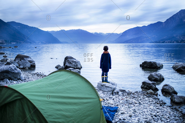 Boy looking out over lake, rear view, Lake Como, Onno, Lombardy, Italy