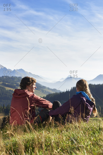 Hikers enjoying view of mountains, Manigod, Rhone-Alpes, France
